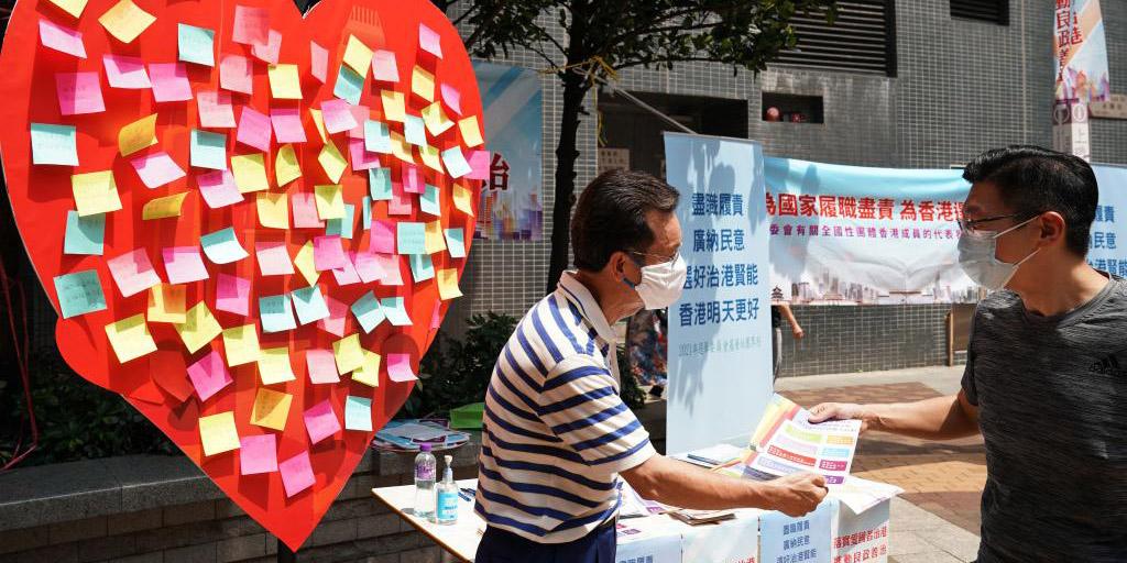 Cerca de mil membros do Comitê Eleitoral realizam campanha nas ruas para ouvir opinião pública em Hong Kong