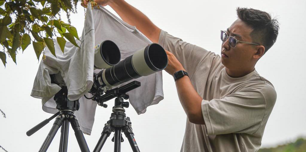 Fotos: entusiastas da fotografia com interesse especial em astronáutica na Província de Hainan